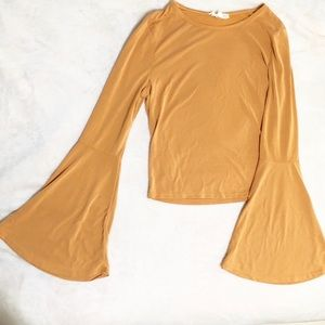 Crop top w/ huge long bell sleeves. Super soft!